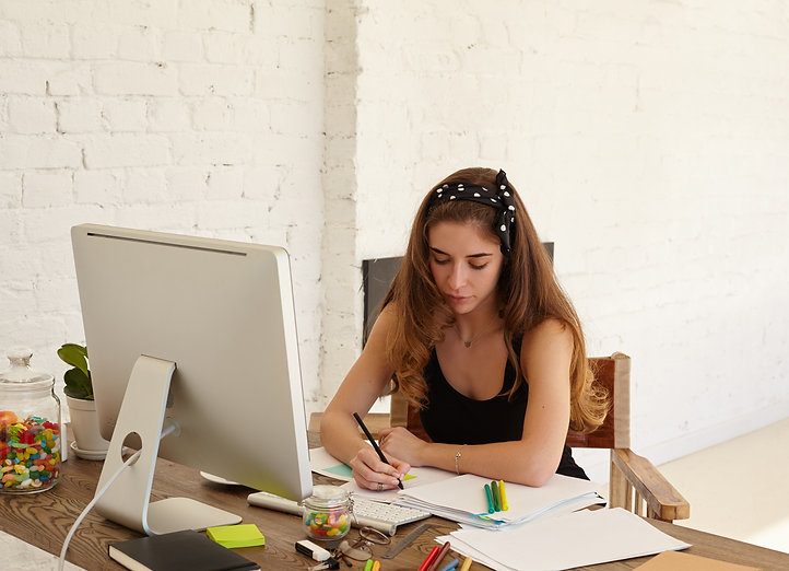 portrait-of-mindful-young-female-studyin