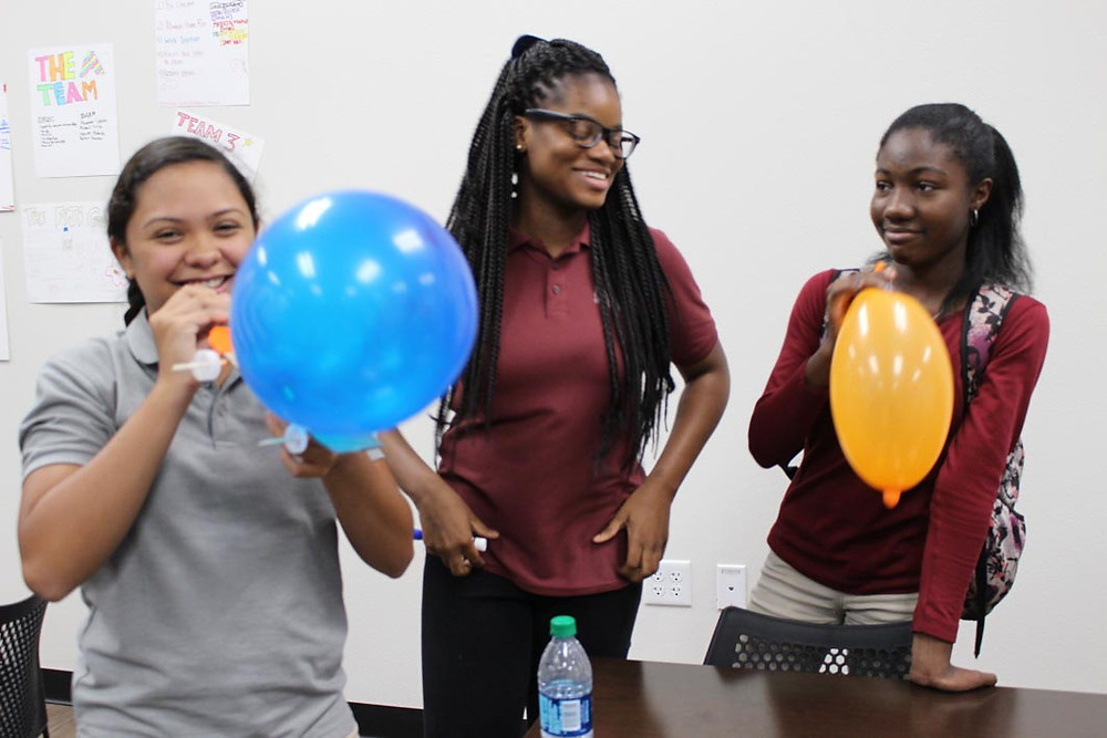 Middle school girls pose inside of the design thinking lab