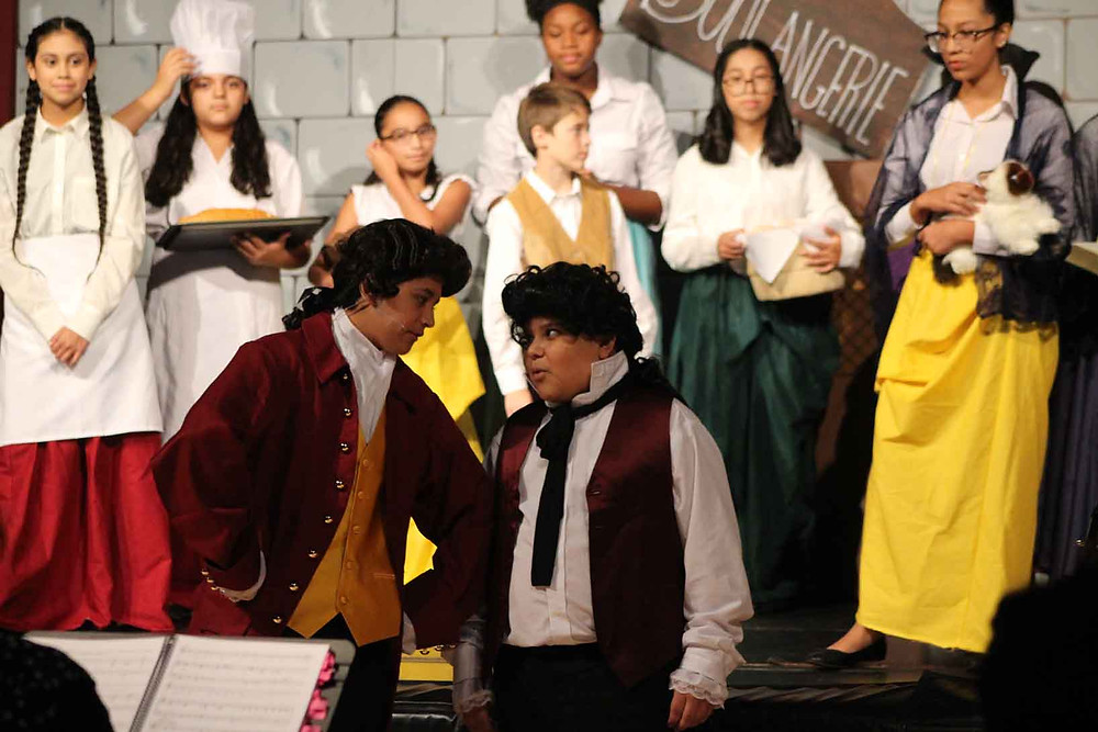 Gaston and Lefoo sing in ACA's production of Beauty and the Beast Jr.