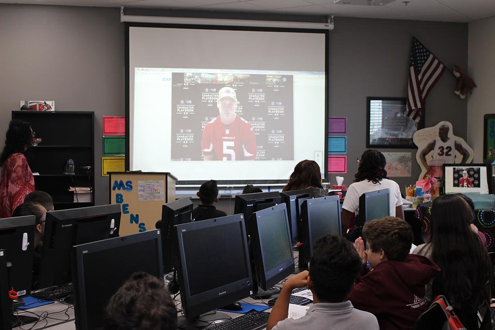 Students talk with Drew Stanton of the Arizona Cardinals