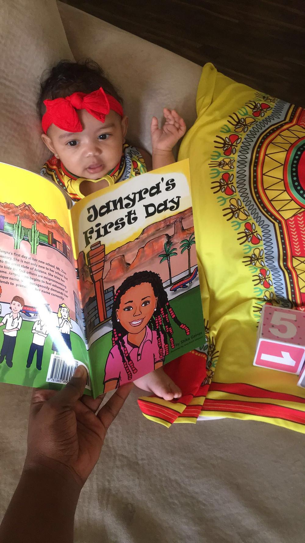 Picture of Shika's daughter Zion, and her book