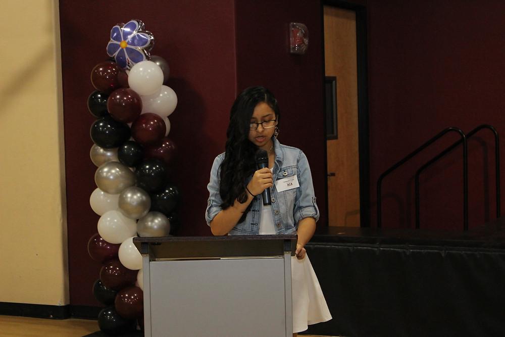 Cassandra Lopez, ACA 8th grader giving speech