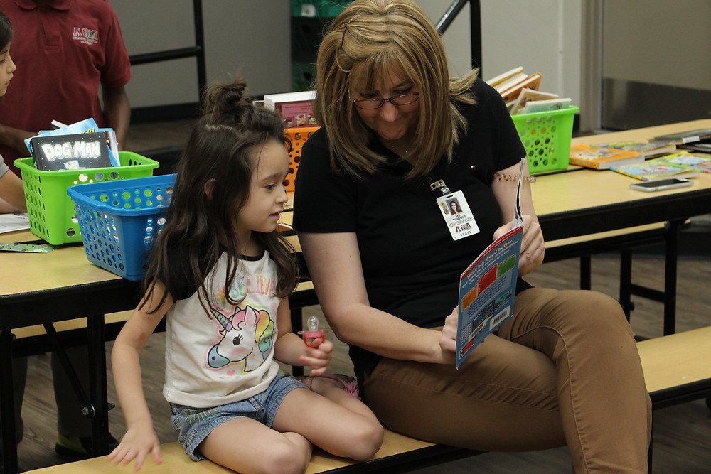 Ms. Townes reading with a student