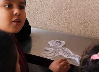 1st Graders Studying Dinosaur Fossils