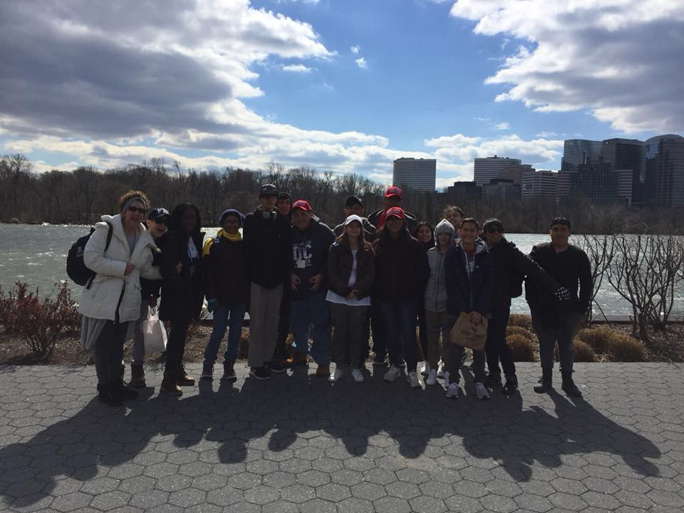 Students in front of the Potomac River.