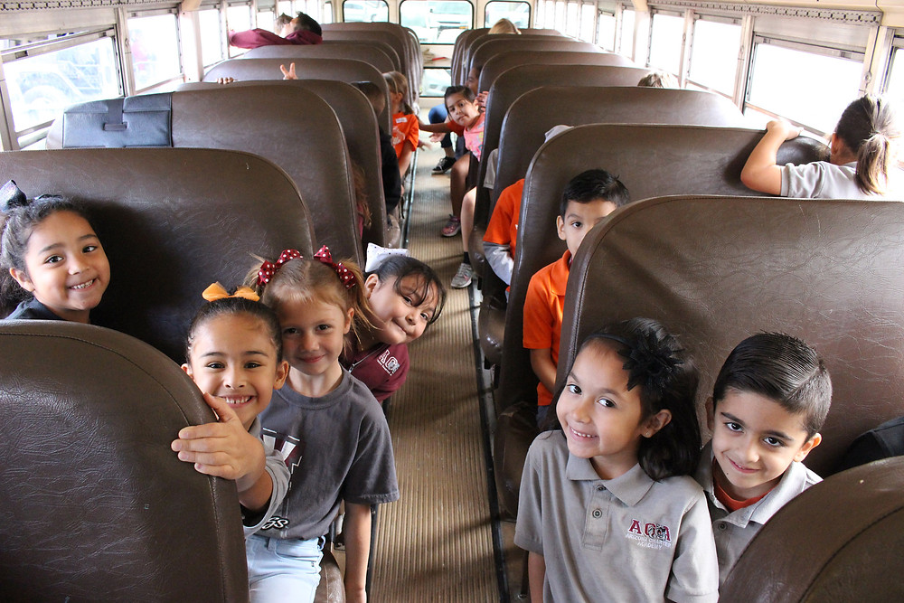 1st graders on the bus on the way to the science center