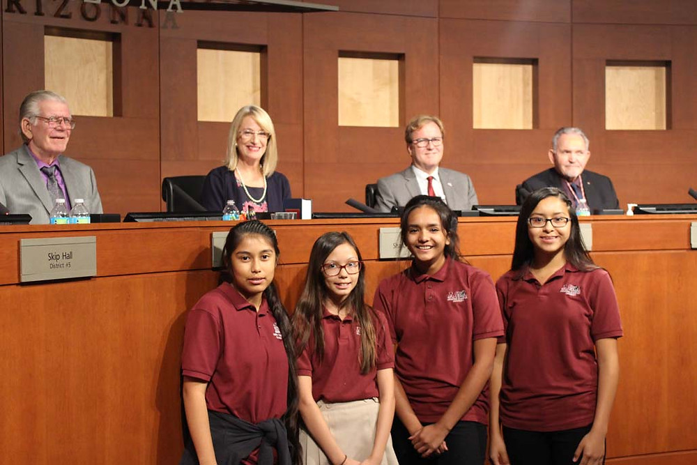 Middle School students pose with City of Surprise Council