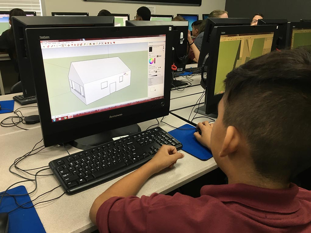 student using CAD program in computer science elective class