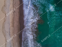 Vertical Long Exposure Waves Breaking on Beach Drone
