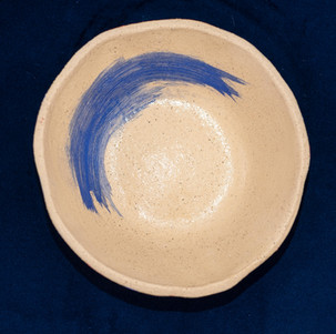Bowl for a human with a blue abstract design inside
