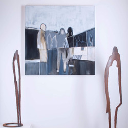 Sculptures stand sentry beside one of my paintings.