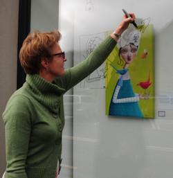 Artist drawing on a window