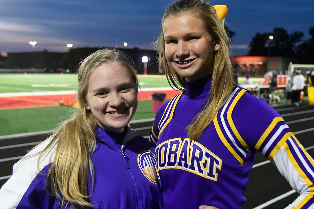 Hobart cheerleaders Kaitlynn Watts, left, and Alyssa Candiano have inspired their teammates, coaches and many others while not allowing their disabilities to define them. (Photo credit: Jeffrey D. Nicholls, The Times)