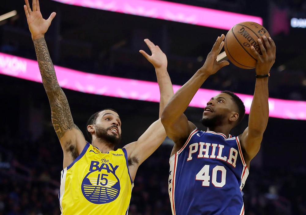 Gary native Glenn Robinson III, right, played his best stretch of professional basketball with the Warriors before being traded to the 76ers, who he is competing with in the NBA bubble. (Photo Credit: AP file photo)