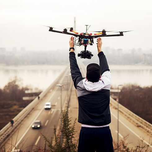 Man holding the drone, preparing for take off..jpg