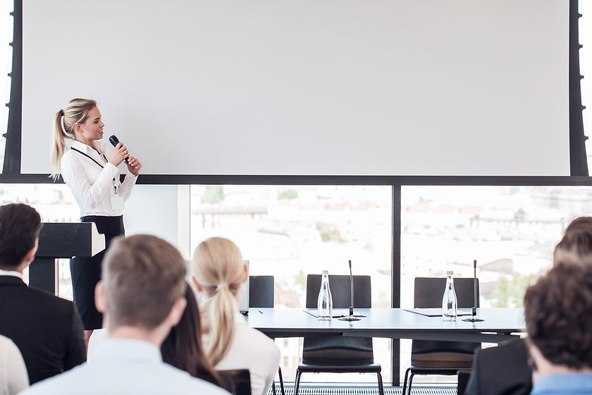 Business woman speaking at presentation