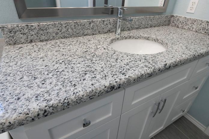 White speckled granite vanity