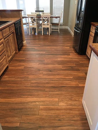 Wood look tile installed in kitchen