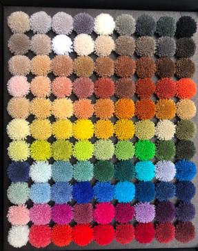 Mouchettes de laine pour concevoir un tapis sur-mesure
