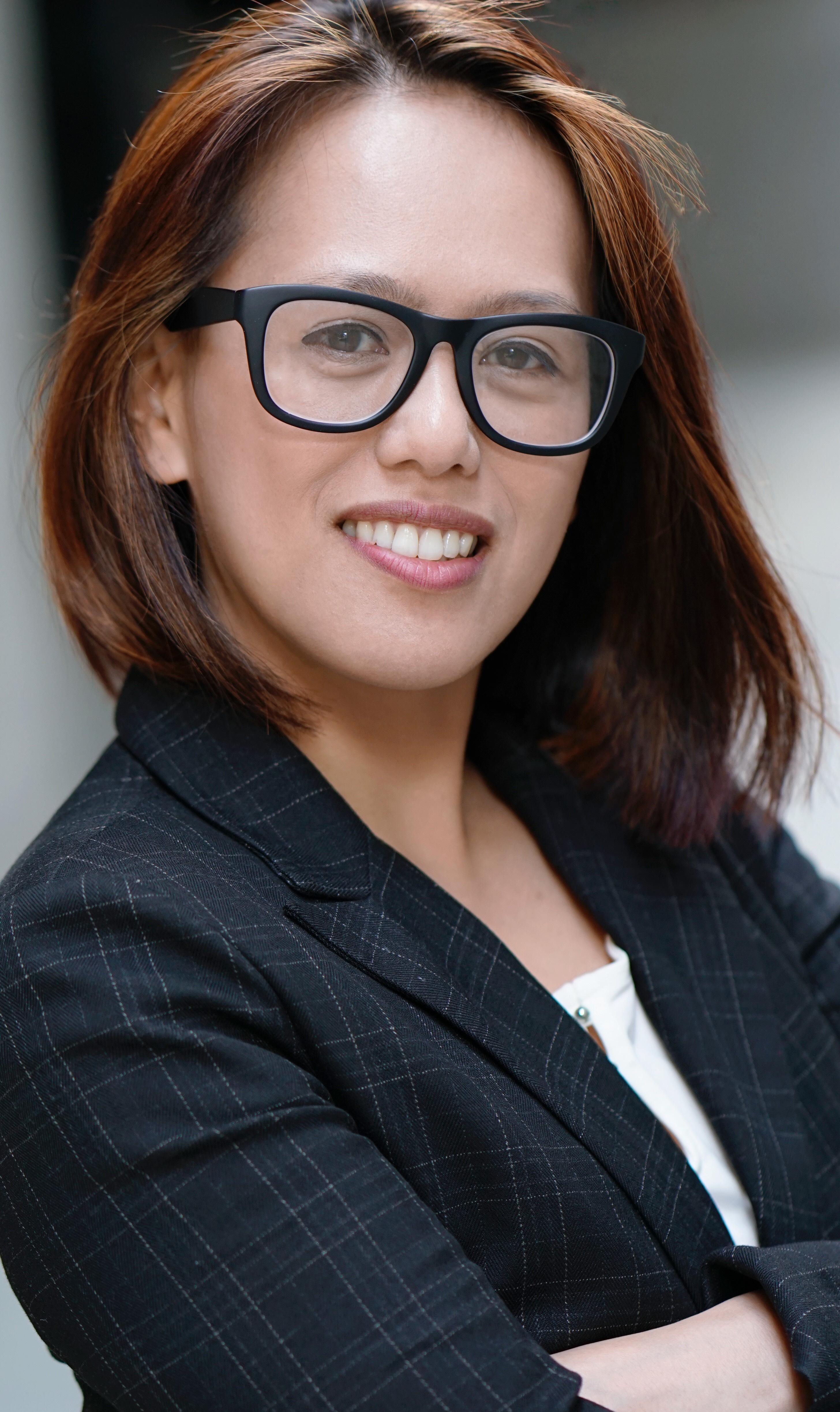 Joyce Lao eyeglass headshot