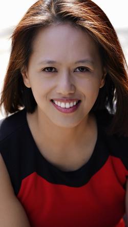 Joyce Lao smiling red and black headshot