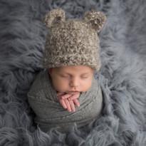 Newborn baby boy in cute eared hat
