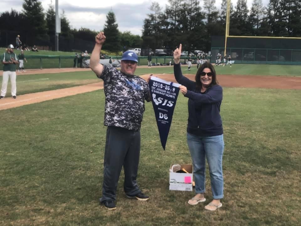 Coach Vivo (L) & Principal Herndon (R) Are Awarded The Championship Banner - Photo By: Josh Whitfield