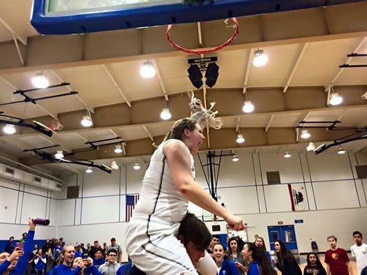 Abby Ridge Cuts Net In Celebration