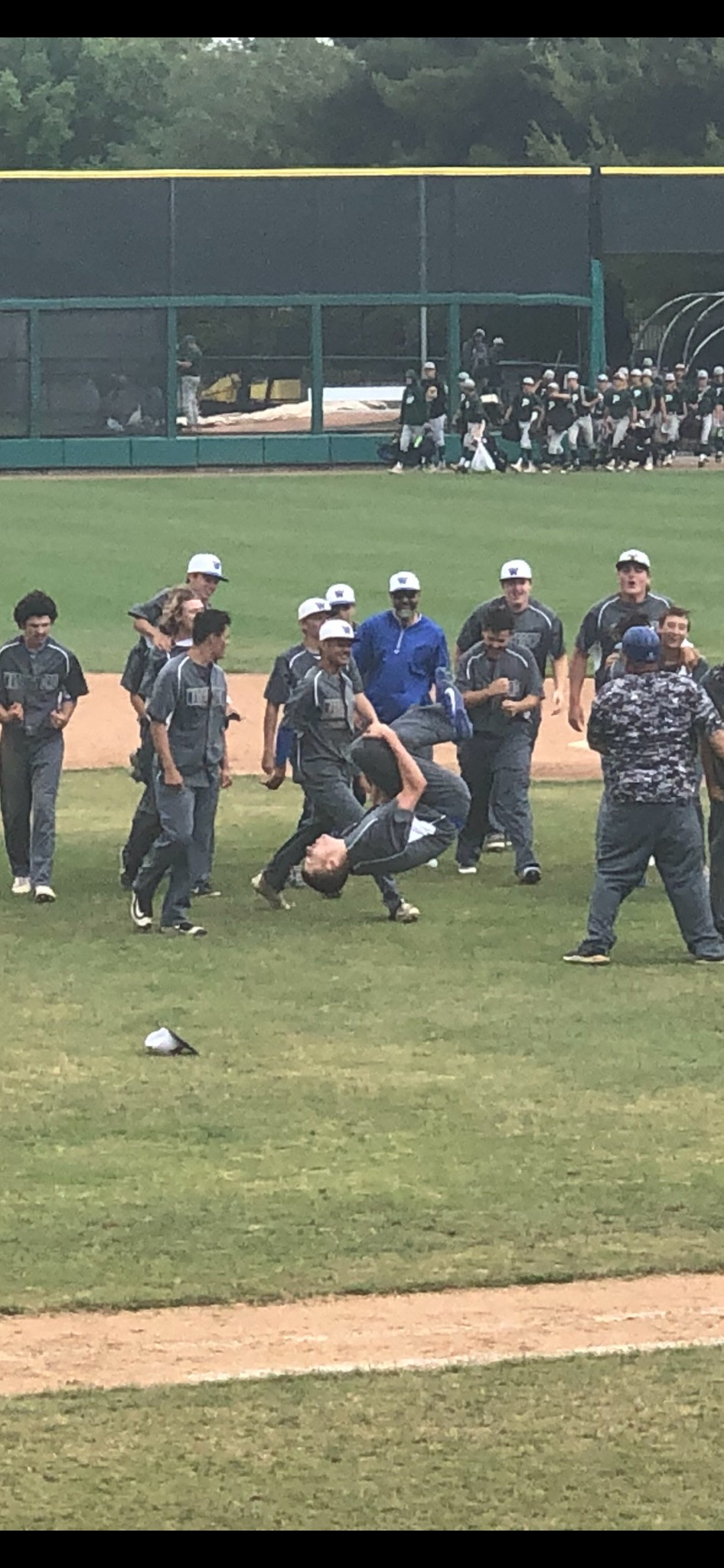 Wildcats Celebrate The Final Out & A Title - Photo By: Kerry Whitfield