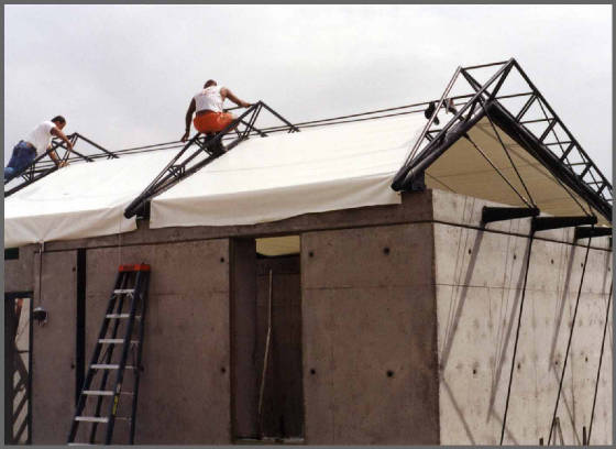 Workers Align Fabric Roof Panels