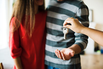 couple-home-house-investment-key-mortgag