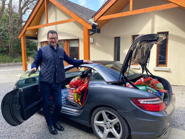David and a car full of donations