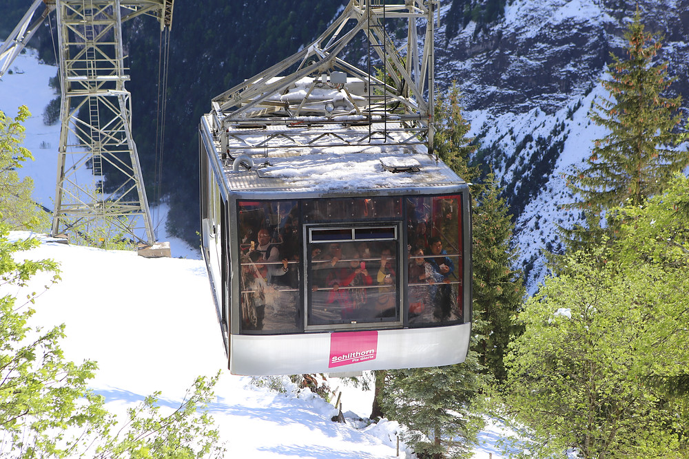 Packed tram of tourists heading up to the Schilthorn