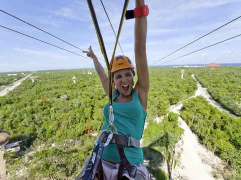 woman-riding-zip-line-with-visible-trail