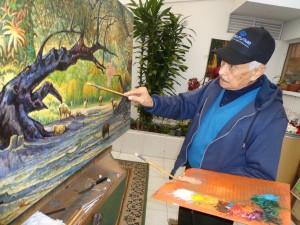 Camilo Medina pintando