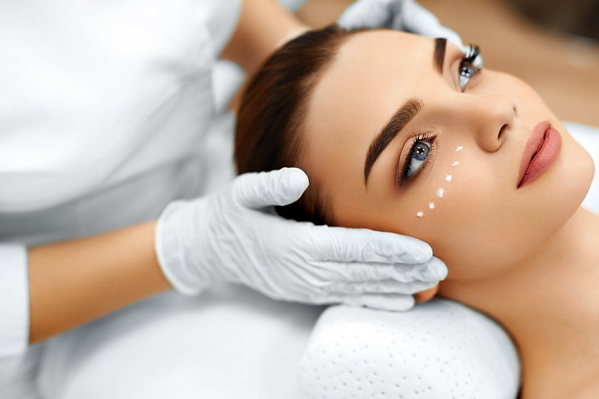 Skin Care. Close-up Of Cosmetician Apply