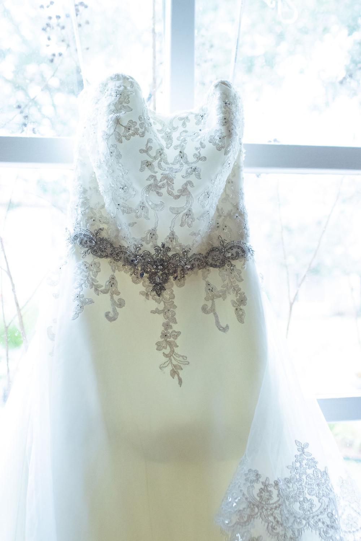 Hanging white dress from David Bridal San antonio