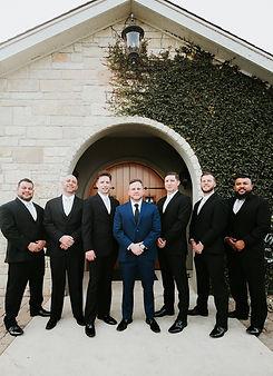 san antonio groomsmen standing and smilling