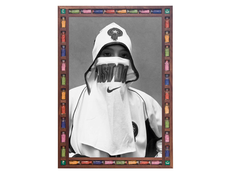Figure 3. Hassan Hajjaj, Just Do It, 2006, C-Print, walnut wood frame and found objects frame, 87 x 62 cm. Courtesy of The Third Line Gallery, Dubai.