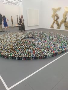 Kader Attia, Halam Tawaaf, 2008. 2,978 beer cans. 500 cm diameter, 15.24 cm length. Installation view at Lehmann Maupin Gallery, Frieze New York 2015.