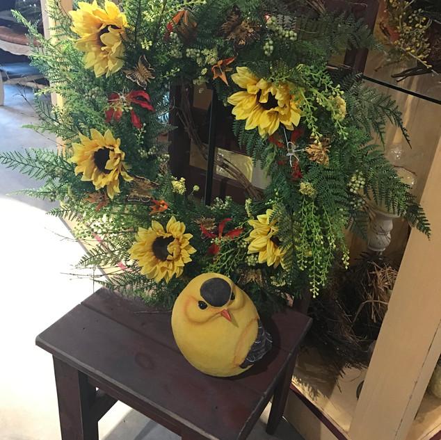 Seasonal Wreaths & Bird Statue