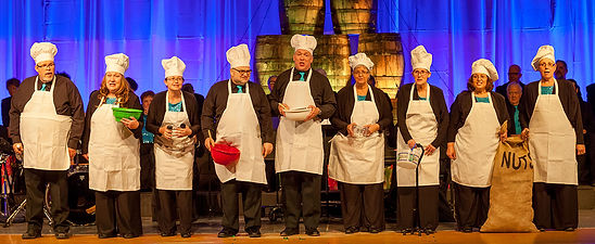 Members of VOICES in chefs aprons and hats