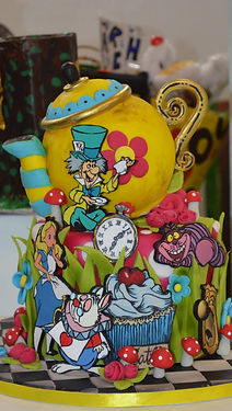 Alice in Wonderland cake with the White  Rabbit, Mad Hatter, Alice and The Cheshire Cat.