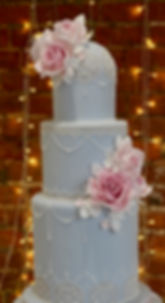 Pink and blue lacy wedding cake