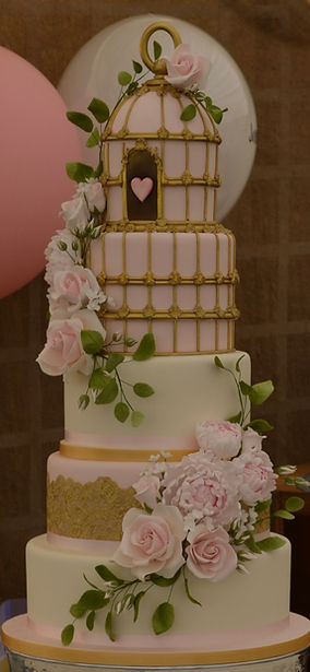 Pink and gold bird cage wedding cake