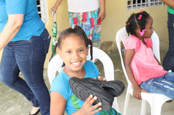 Girl smiling with shoes.JPG