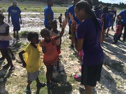 Haiti - Lauren playing pitty pat with Haitian Girls