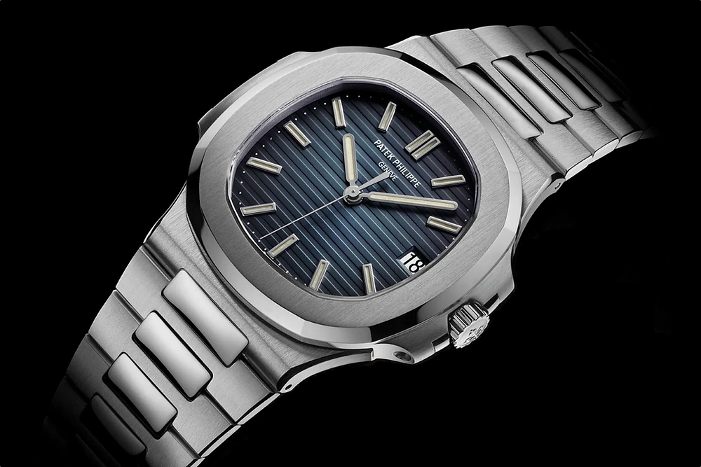 Patek Philippe Nautilus 5711 in stainless steel with blue gradient dial.