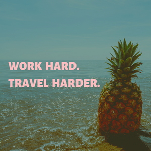 A pineapple on a beach with the saying, Word Hard. Travel Harder.