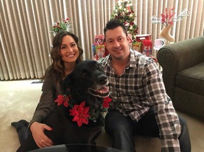 An image of the blogger with her husband and dog.